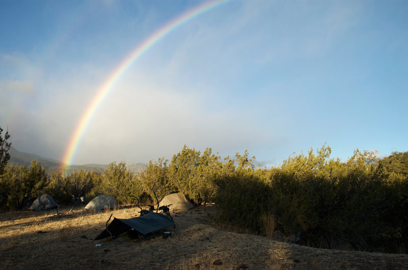 We wake to a double rainbow arching over our camp.